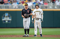 Michigan Wolverines outfielder Jesse Franklin (7) stands of second next to Texas Tech shortstop Josh Jung (16) during Game 1 of the NCAA College World Series against the Texas Tech Red Raiders on June 15, 2019 at TD Ameritrade Park in Omaha, Nebraska. Michigan defeated Texas Tech 5-3. (Andrew Woolley/Four Seam Images)