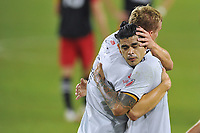 WASHINGTON, DC - SEPTEMBER 27: Adam Buska #9 of New England Revolution celebrates his score with teammate Gustavo Bou #7 during a game between New England Revolution and D.C. United at Audi Field on September 27, 2020 in Washington, DC.