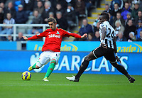 Saturday 17 November 2012<br /> Pictured L-R: Pablo Hernandez of Swansea taking a shot off target while being closely marked by Cheick Tiote of Newcastle. <br /> Re: Barclay's Premier League, Newcastle United v Swansea City FC at St James' Park, Newcastle Upon Tyne, UK.