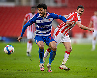 6th February 2021; Bet365 Stadium, Stoke, Staffordshire, England; English Football League Championship Football, Stoke City versus Reading; Josh Laurent of Reading under pressure from Joe Allen of Stoke City