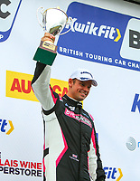 30th August 2020; Knockhill Racing Circuit, Fife, Scotland; Kwik Fit British Touring Car Championship, Knockhill, Race Day; Tom Chilton holds up his 3rd place trophy after round 12 of the BTCC