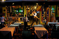Ceci tango dances with her dancing partner Meme at a restaurant in the El Caminito area of Buenos Aires where they work. They dance together most of the time as it is better to have partners who know each other's movements and can choreograph together.