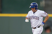 Round Rock Express designated hitter Lance Berkman (12) jogs around the bases after hitting a home run during the Pacific Coast League baseball game against the Salt Lake Bees on August 10, 2013 at the Dell Diamond in Round Rock, Texas. Round Rock defeated Salt Lake 9-6. (Andrew Woolley/Four Seam Images)