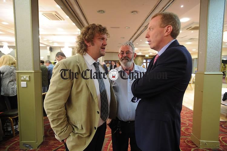 Fianna Fail's Alan O Callaghan chatting with Clare TD Timmy Dooley and Joe Mc Enery during the election count at The West county Hotel, Ennis. Photograph by John Kelly.