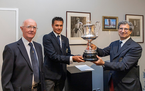 (Left to Right) John Taylor - RUYC, Aaron Young - Commodore RNZYS, Agostino Randazzo - Commodore Circolo Della Vella Sicilia YC in Sicily receiving the Sir Thomas Lipton Memorial Cup