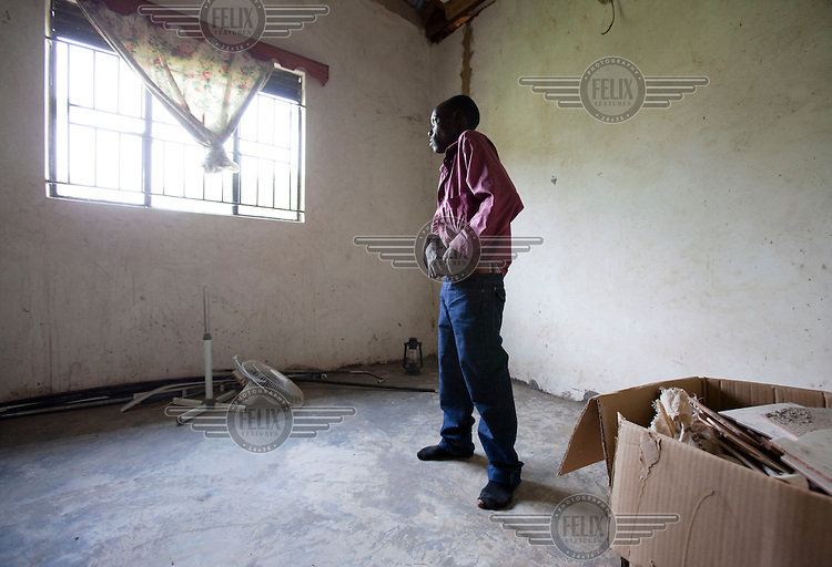 Buyinza Nsimbe, brother-in-law of murdered gay rights activist David Katos, inside Katos' empty house at the spot he died. He was murdered soon after the tabloid newspaper Rolling Stone published his name on its front page. The paper infamously ran a homophobic story with the headline 'Hang Them'