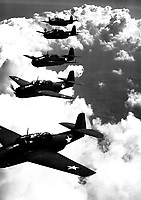 TBF (Avengers) flying in formation over Norfolk, Va.  September 1942.  Attributed to Lt. Comdr. Horace Bristol.  (Navy)<br /> Exact Date Shot Unknown<br /> NARA FILE #:  080-G-427475<br /> WAR & CONFLICT BOOK #:  962