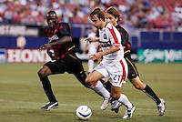 The Fire's Justin Mapp is double teamed by the MetroStars' Tenywa Bonseu and Mike Magee. The Chicago Fire were defeated by the NY/NJ MetroStars 2-1 at Giant's Stadium, East Rutherford, NJ, on July 24, 2004.