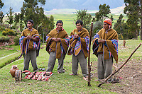 Peru, Urubamba Valley, Quechua Village of Misminay.  Village Men Holding Coca Leaves Performing a Welcoming Ceremony for Guests.