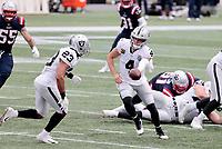 27th September 2020, Foxborough, New England, USA;  Las Vegas Raiders quarterback Derek Carr (4) hands off to Las Vegas Raiders running back Devontae Booker (23) during the game between the New England Patriots and the Las Vegas Raiders