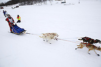 Joshua Klejka and dog team leaves the start line of the 2013 Junior Iditarod on Knik Lake.  Knik Alaska..Photo by Jeff Schultz/IditarodPhotos.com   Reproduction prohibited without written permission