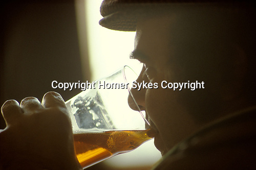 1980s older working class man having a lunch time drink, drinking a pint of beer in local pub Scunthorpe  Lincolnshire 1981 UK