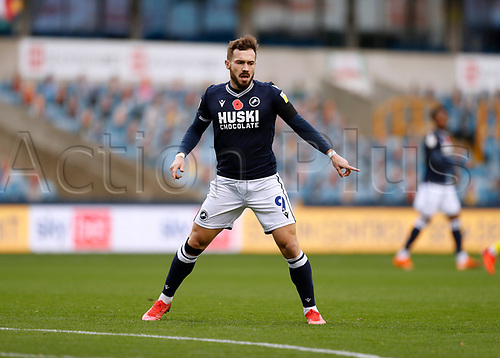 31st October 2020; The Den, Bermondsey, London, England; English Championship Football, Millwall Football Club versus Huddersfield Town; Tom Bradshaw of Millwall with a red poppy symbol on the front of this shirt symbolise Remembrance Sunday on the 11th November