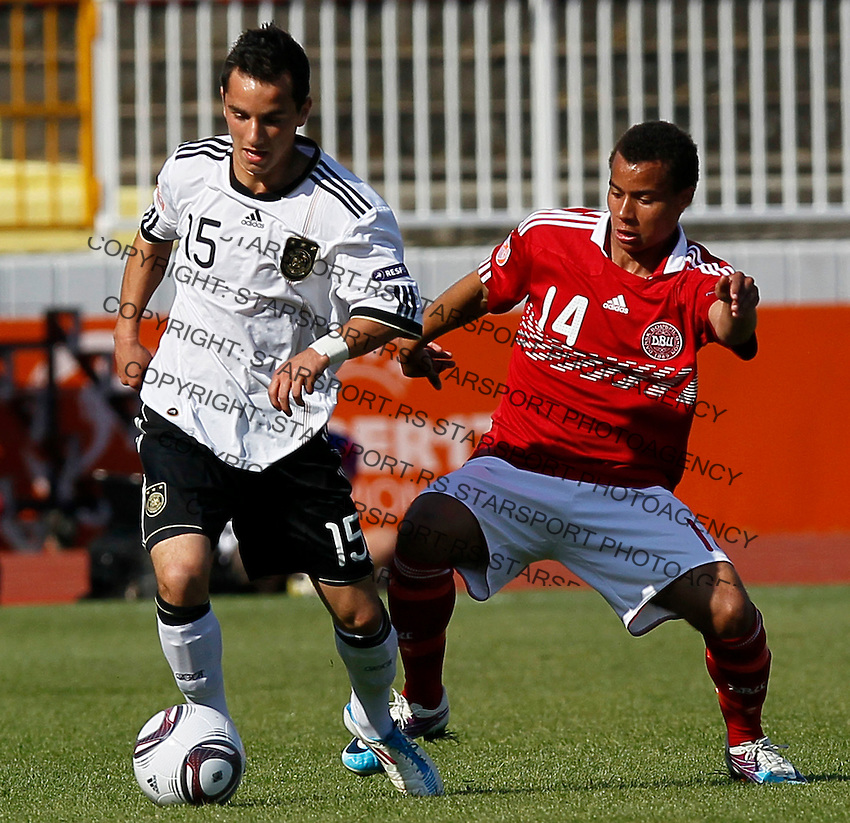 Okan Aydin (L) of Germany challenged by Derrick Nissen of Denmark during the UEFA U17 Championships Semi Final match between Denmark and Germany on May 12, 2011 in Novi Sad, Serbia. (Photo by Srdjan Stevanovic/Starsportphoto.com)