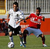 Okan Aydin (L) of Germany challenged by Derrick Nissen of Denmark during the UEFA U17 Championships Semi Final match between Denmark and Germany on May 12, 2011 in Novi Sad, Serbia. (Photo by Srdjan Stevanovic/Starsportphoto.com)