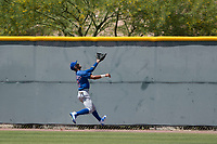 Chicago Cubs center fielder Jose Gonzalez (21) pursues a fly ball during an Extended Spring Training game against the Colorado Rockies at Sloan Park on April 17, 2018 in Mesa, Arizona. (Zachary Lucy/Four Seam Images)