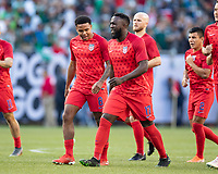 CHICAGO, IL - JULY 7: Jozy Altidore #17 and Weston Mckennie #8 warm up prior to the match during a game between Mexico and USMNT at Soldiers Field on July 7, 2019 in Chicago, Illinois.