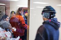 Esperanza Moctezuma, center in black headband, at an HOLA meeting in Painesville, Ohio. Hola meets weekly and people share deportation stories and inform other community members of thier ongoing immigration struggles. Thier children also come to the meetings at  LifeSpring HUB Christian Church. The youngest partcipate in activities in an adjacent storefront. March 25, 2014. Photo by Brendan Bannon.