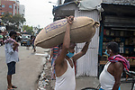 A daily wage laborer carries a sack on his head at burrabazzar in Kolkata.  Whole sale market reopened in Kolkata few days back midst 21 days lock down in India due to covid 19 pandemic. Kolkata, West Bengal, India. Arindam Mukherjee.