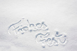 Oesterreich, Salzburger Land, Pinzgau, Maria Alm: 'Frohes Fest' in den Schnee geschrieben | Austria, Salzburger Land, Pinzgau, Maria Alm: German 'Frohes Fest' (Merry Christmas) written in the snow