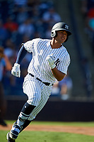 New York Yankees second baseman Wilkerman Garcia (64) runs to first base during a Grapefruit League Spring Training game against the Toronto Blue Jays on February 25, 2019 at George M. Steinbrenner Field in Tampa, Florida.  Yankees defeated the Blue Jays 3-0.  (Mike Janes/Four Seam Images)