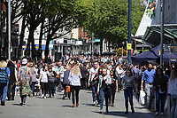 Pictured: A crowd at the junction of Union and Oxford Street in Swansea city centre with the entrance to the Quadrant in the background Wednesday 24 May 2017<br />Re: The Quadrant shopping centre in Swansea has been evacuated following reports of a suspicious package being found.<br />The bus station and Swansea Indoor Market have also been closed as part of the evacuation.