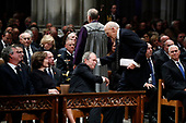Former President George W. Bush shakes hands with former Sen. Alan Simpson, R-Wyo, after he spoke during the State Funeral for former President George H.W. Bush at the National Cathedral, Wednesday, Dec. 5, 2018, in Washington. Watching are Jeb Bush and Laura Bush. At right is Vice President Mike Pence. <br /> Credit: Alex Brandon / Pool via CNP