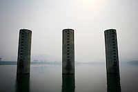 CHINA. Hubei Province. A view of the 3 Gorges Dam.  The flooding of the three Gorges, by damming the Yangtze near the town of YiChang, has remained a controversial subject due to the negative environmental consequences and the displacement of millions of people in the flood plain. The Yangtze River however is reported to be at its lowest level in 150 years as a result of a country-wide drought. It is China's longest river and the third longest in the world. Originating in Tibet, the river flows for 3,964 miles (6,380km) through central China into the East China Sea at Shanghai.  2008.