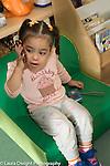 Education Preschool Two year old program girl talking on cell telephone