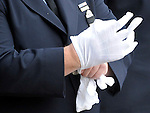 Ceremonial dress white gloves, worn by all the firefighters,  during the funeral service, Monday, Oct. 13, 2014, at First Cathedral Church in Bloomfield. Bell was killed at a house fire in last week Hartford. (Jim Michaud / Journal Inquirer)