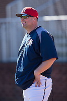 Shippensburg Raiders head coach Matt Jones watches his team take infield practice prior to the game against the Belmont Abbey Crusaders at Abbey Yard on February 8, 2015 in Belmont, North Carolina.  The Raiders defeated the Crusaders 14-0.  (Brian Westerholt/Four Seam Images)