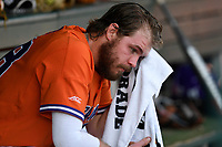 Right fielder Seth Beer (28) of the Clemson Tigers towels off from the dugout in a game against the William and Mary Tribe on February 16, 2018, at Doug Kingsmore Stadium in Clemson, South Carolina. Clemson won, 5-4 in 10 innings. (Tom Priddy/Four Seam Images)