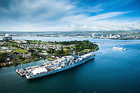 An aerial image of the USS Missouri and Arizona Memorial in the afternoon on O'ahu.