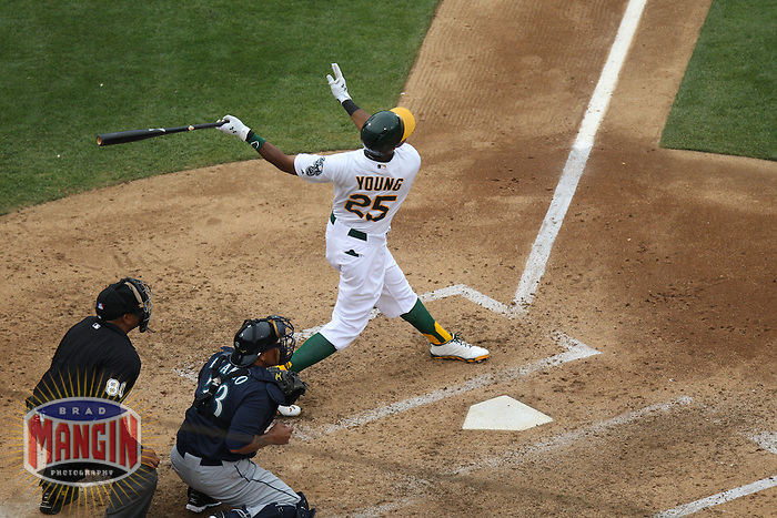 OAKLAND, CA - JUNE 15:  Chris Young #25 of the Oakland Athletics bats against the Seattle Mariners during the game at O.co Coliseum on Saturday June 15, 2013 in Oakland, California. Photo by Brad Mangin