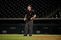 Home plate umpire Cas Cousins between innings of an Arizona League game between the AZL Giants Orange and the AZL Cubs 1 on July 10, 2019 at Sloan Park in Mesa, Arizona. The AZL Giants Orange defeated the AZL Cubs 1 13-8. (Zachary Lucy/Four Seam Images)
