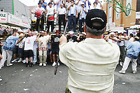 """A """"capo"""" yells out instructions to the lifters (or """"Paranza"""") at the annual Feast of Our Lady of Mount Carmel and the Dancing of the Giglio in Brooklyn, NY, on July 18, 2004."""