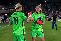 ORLANDO, FL - MARCH 05: Ashlyn Harris #18 and Alyssa Naeher #1 of the United States shake hands during a game between England and USWNT at Exploria Stadium on March 05, 2020 in Orlando, Florida.