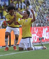 BARRANQUILLA - COLOMBIA -29-03-2016: Juan G Cuadrado (Izq.) y Carlos Bacca (Der.) jugadores de Colombia, celebran el tercer gol anotado a Ecuador, durante partido entre los seleccionados de Colombia y Ecuador, por la fecha 6 para la clasificación sudamericana a la Copa Mundial de la FIFA Rusia 2018, jugado en el estadio Metropolitano Roberto Melendez en Barranquilla. / Juan G Cuadrado (L) and Carlos Bacca (R) players of Colombia, celebrate the third goal scored to Ecuador, during match between the teams of Colombia and Ecuador, for the date 6 for the Qualifier FIFA World Cup Russia 2018, played at Metropolitan stadium Roberto Melendez in Barranquilla. Photo: VizzorImage / Luis Ramirez / Staff.