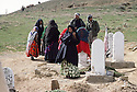 Iran 1981.In the cemitery of Oushnavieh, a family meditate beside the gravestone of a peshmerga ( Kurdish fighter )