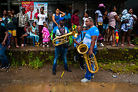 Afro-Colombian brass players of the Pandeyuca neighborhood take part in the San Pacho festival in Quibdó, Colombia, 29 September 2019. Every year at the turn of September and October, the capital of the Pacific region of Chocó holds the celebrations in honor of Saint Francis of Assisi (locally named as San Pacho), recognized as Intangible Cultural Heritage by UNESCO. Each day carnival groups, wearing bright colorful costumes and representing each neighborhood, dance throughout the city, supported by brass bands playing live music. The festival culminates in a traditional boat ride on the Atrato River, followed by massive religious processions, which accent the pillars of Afro-Colombian's identity – the Catholic devotion grown from African roots.