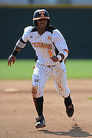 Khayyan Norfork #8 of the Tennessee Volunteers runs to third at Lindsey Nelson Stadium against the the Manhattan Jaspers on March 12, 2011 in Knoxville, Tennessee.  Tennessee won the first game of the double header 11-5.  Photo by Tony Farlow / Four Seam Images...