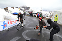 24th May 2021, Giau Pass, Italy; Giro d'Italia, Tour of Italy, route stage 16, Sacile to Cortina d'Ampezzo ; Fans urge on a rider and one with a chain saw for effect