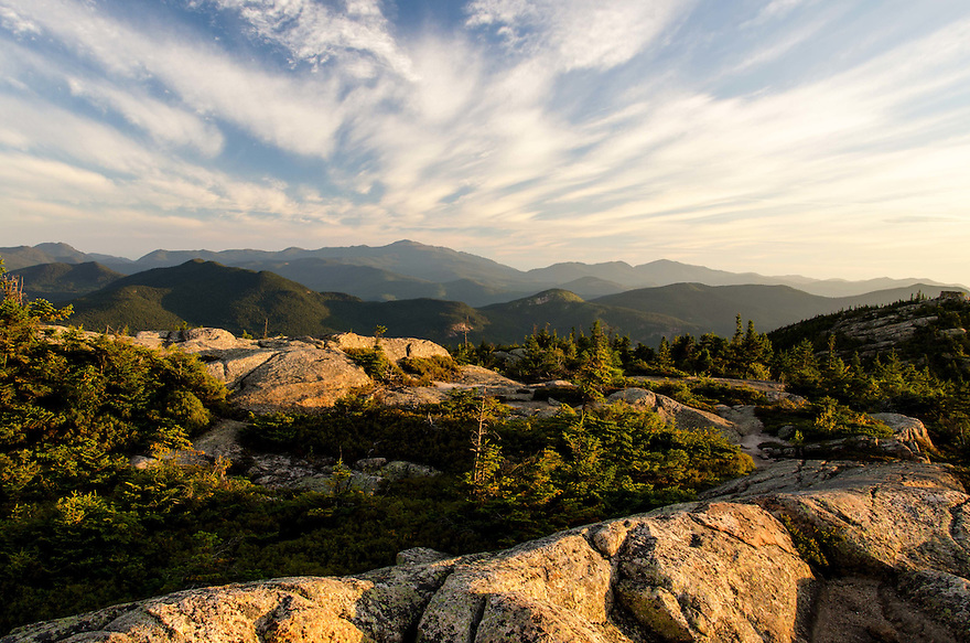 A wild sky morning from atop a peak in New Hampshires White Mountains.