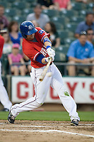 Outfielder Craig Gentry ##23 of the Round Rock Express swings against the Oklahoma City RedHawks on April 26, 2011 at the Dell Diamond in Round Rock, Texas. (Photo by Andrew Woolley / Four Seam Images)
