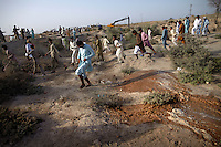 Men run from flood water as it inundates the surrounding area after Manchar Lake bursts its banks. Officials  made a breach in the lake's embankments to direct water away from the nearby cities of Dadu and Sehwan, in Sindh Province, Pakistan.