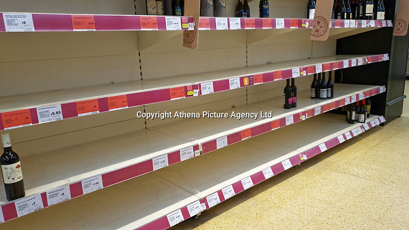 Pictured: Empty shelves in the red wine section, leaving available only the most expensive at the top shelf in the Sainsbury's super market, in Swansea, Wales, UK. <br /> Re: Covid-19 Coronavirus pandemic, UK.