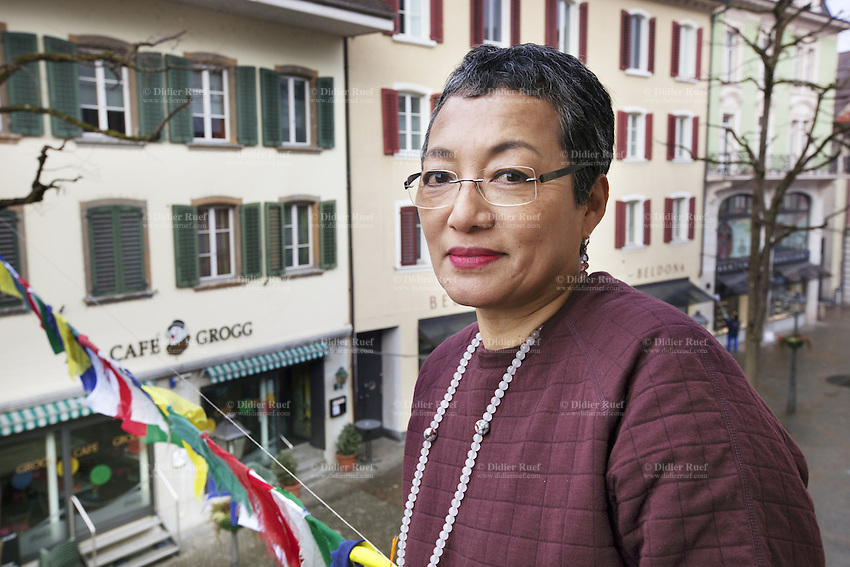 Switzerland. Canton Solothurn. Olten. Dolma Knell stands on her home's balcony. Lung ta are tibetan prayer flags of square or rectangular shape, and are connected along their top edges to a long string or thread. The swiss tibetan woman is an Aeschimann's child who arrived 50 years ago in Switzerland to receive custody on a private initiative by an influential Swiss industrialist, Charles Aeschimann. In 1962, Charles Aeschimann agreed with the Dalai Lama to take 200 children and place them in Swiss foster homes and give them a chance for a better life and a good education. Most of the children still had parents in exile or in Tibet, just a few were orphans. 25.02.2015 © 2015 Didier Ruef