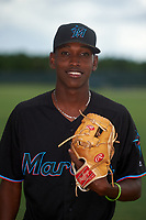 GCL Marlins Daniel Paulino (5) poses for a photo after a Gulf Coast League game against the GCL Cardinals on August 12, 2019 at the Roger Dean Chevrolet Stadium Complex in Jupiter, Florida.  GCL Marlins defeated the GCL Cardinals 9-2.  (Mike Janes/Four Seam Images)