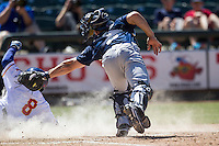 New Orleans Zephyrs catcher Rob Brantley #6 attempts to tag Round Rock Express base runner Kensuke Tanaka #8 during the Pacific Coast League baseball game on May 4, 2014 at the Dell Diamond in Round Rock, Texas. The Express defeated the Zephyrs 15-12. (Andrew Woolley/Four Seam Images)