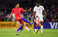 ORLANDO, FL - NOVEMBER 15: Weston McKennie #8 of the United States and Alphonso Davies #12 of Canada battle for a ball during a game between Canada and USMNT at Exploria Stadium on November 15, 2019 in Orlando, Florida.